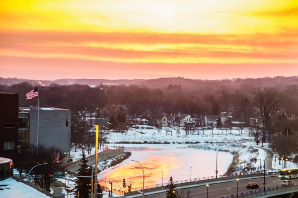 The sun sets on a frozen river during winter in Rochester, Minnesota