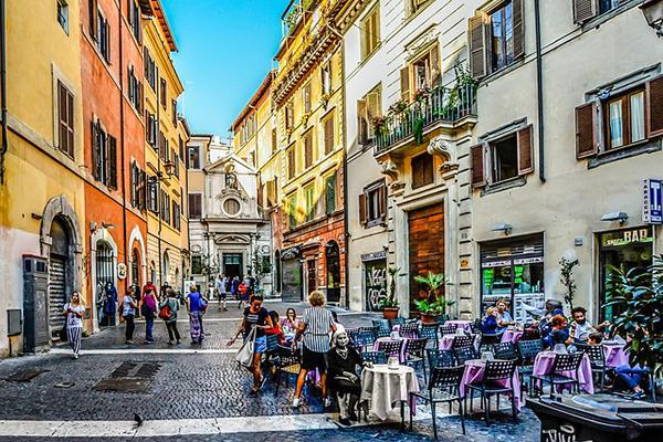 City dwellers lounge around at a Roman Piazza in Rome, Italy