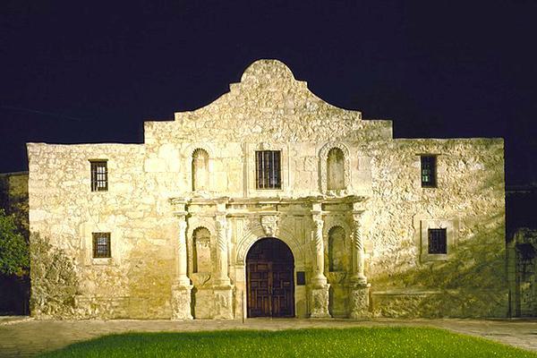 The historic Alamo stands tall on a dark night in San Antonio, Texas