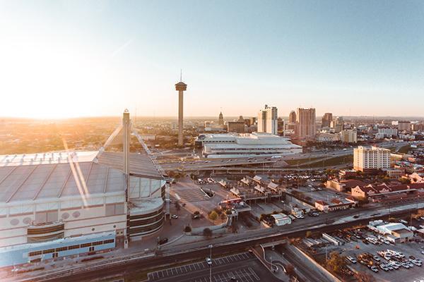 The sun shines brightly over the San Antonio skyline in Texas