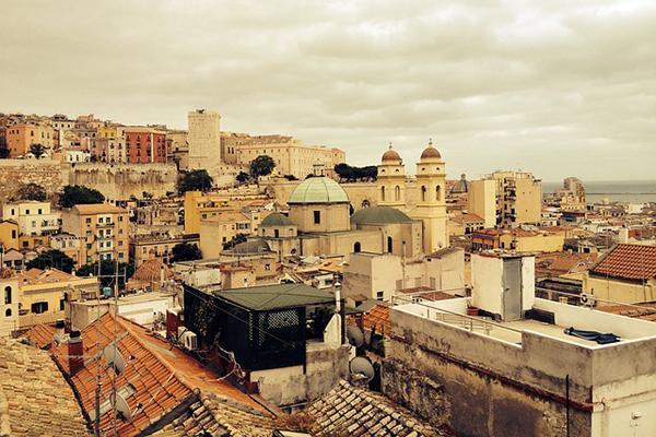 Old, Mediterranean architecture fills the frame in Cagliari, Sardinia, Italy