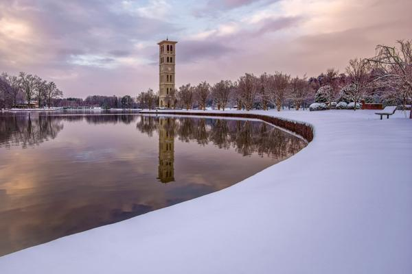 A clock tower reflects off the still waters at Furman University in Greenville, South Carolina