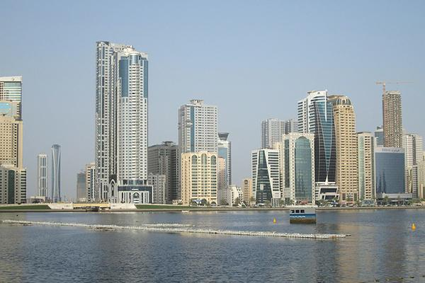 Tall buildings line the waterfront of Sharjah, United Arab Emirates