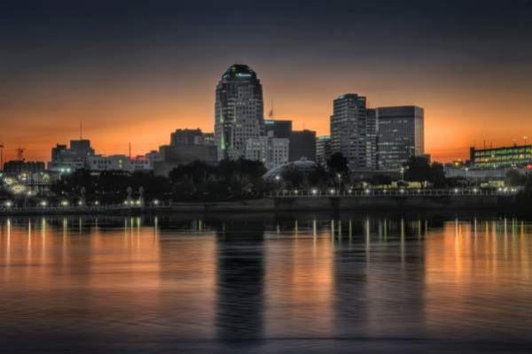 Downtown Shreveport's skyline by sunset.