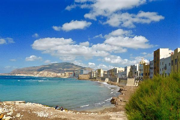 Colourful, medieval buildings line the shore in Trapani, Sicily, Italy