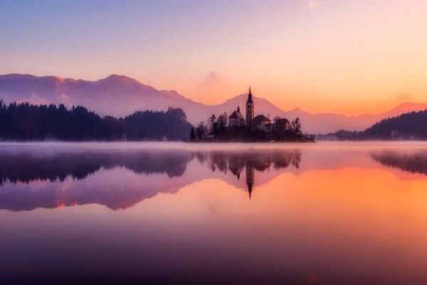 Bled, a Slovenian resort town in the foothills of the Julian Alps, is set along the glacial Lake Bled.