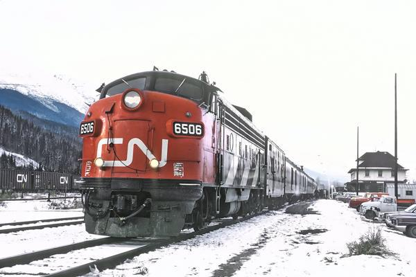 A train awaits departure from a station in Smithers, Canada