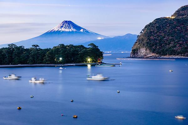 A view of the iconic, snow-capped Mount Fuji from Heda, Japan at sunset