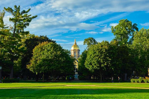 The main administrative building set among the perfectly manicured lawns of the University of Notre Dame in South Bend, Indiana