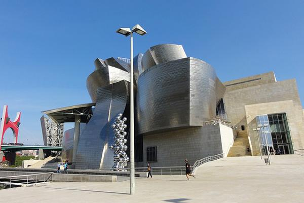 The uniquely shaped Guggenheim Museum, Bilbao looking fresh on a beautiful day in Bilbao, Spain