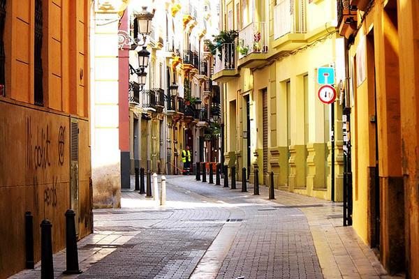 The pretty, narrow streets and flower adorned balconies of Valencia, Spain