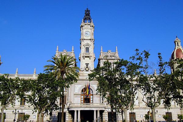 The Plaza de Ayuntamiento standing tall on a beautiful day in Valencia, Spain