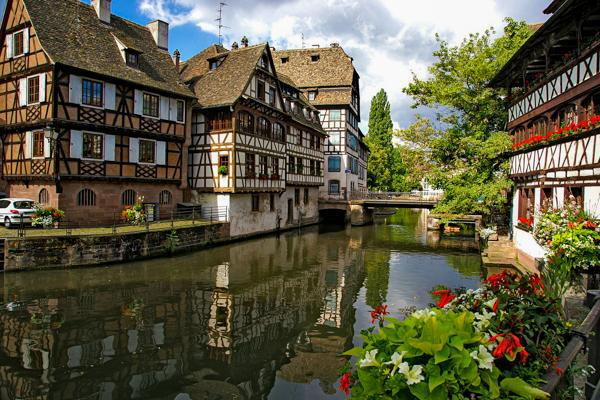 A picture of serenity where flowers bloom along the canals of Strasbourg, France