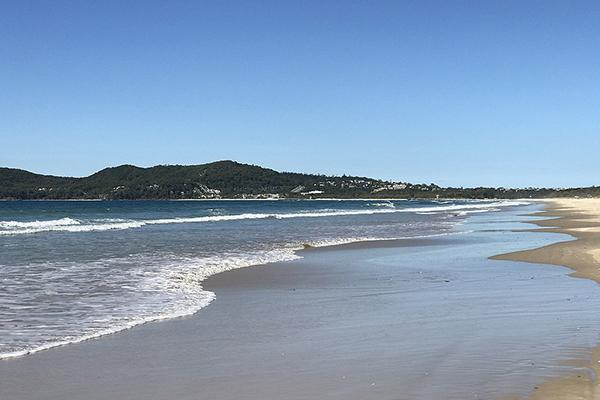 Waves roll up along the beach at Noosa North Shore in Australia