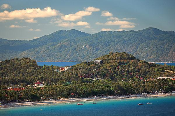 Surat Thani sits in the background contrasted by the vibrant tropical island of Koh Samui.