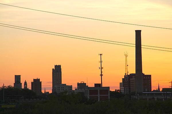 The setting sun paints the sky orange in downtown Abilene, Texas
