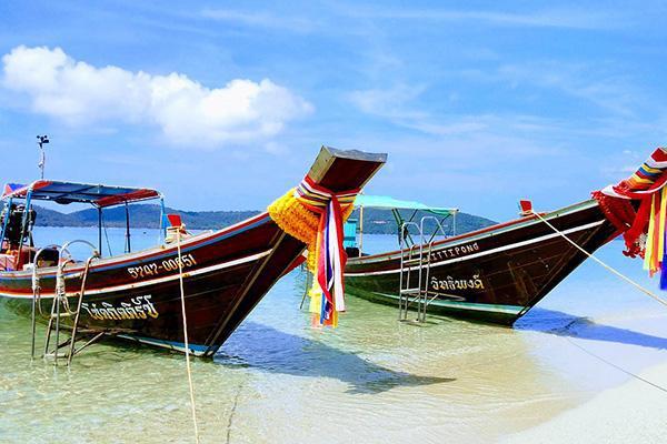 Two longboats on the idyllic shores of Koh Samui, Thailand