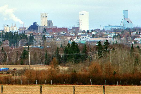 Skyline view of Timmins, Ontario with the town water tower off in the distance