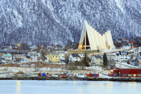 The Arctic Cathedral stands proud amidst the older buildings of Tromso