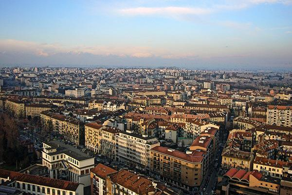 The crowded skyline of Turin, Italy at dusk