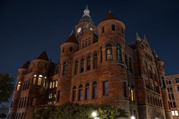 The historic Dallas County Courthouse is lit up on a clear evening in Dallas, Texas