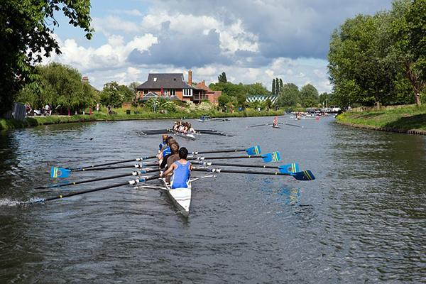 Rowers rowing boats at Cambridge University, United Kingdom