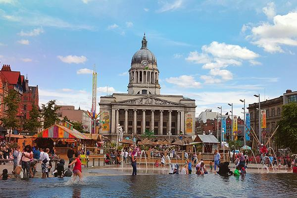 People gather at the Nottingham Town Hall and Market Square