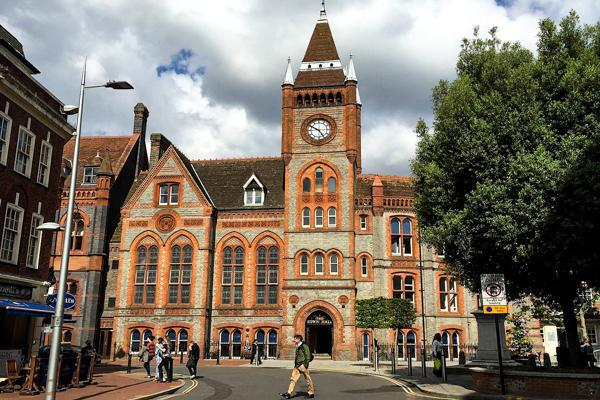 The streets are busy around the Town Hall Building in Reading, United Kingdom