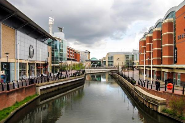 Locals and tourists alike walk along the River Kennet in Reading, United Kingdom