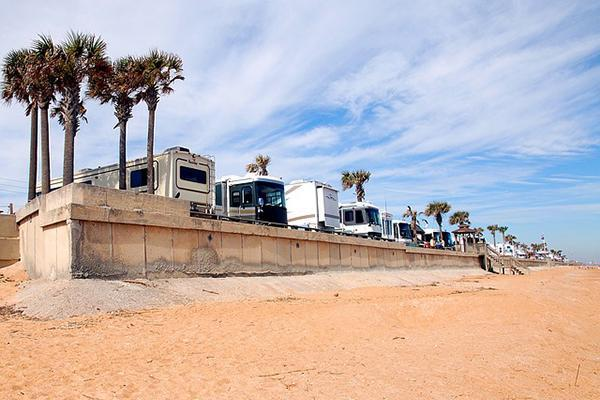 Motorhomes fill a beachside camping bay in Florida, USA