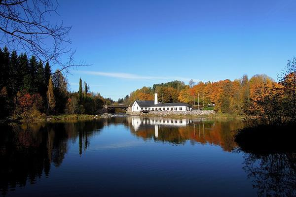 A beautiful autumn river landscape shot of Vantaankoski Railway Station in Vantaa, Finland