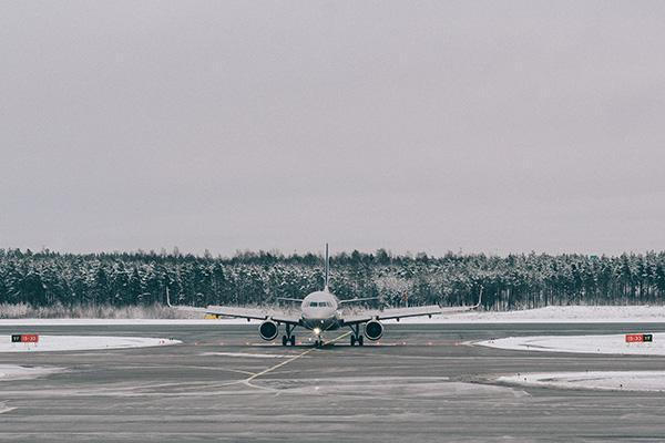 A plane on the tarmac during winter at Helsinki Airport, Vantaa, Finland