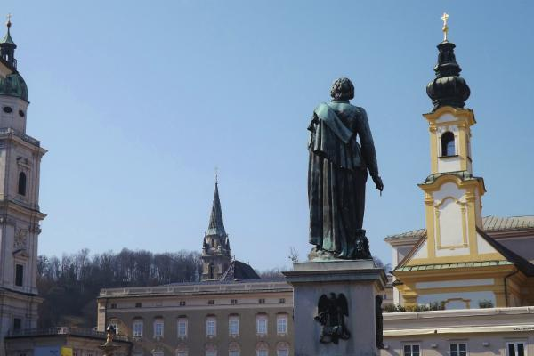 A statue of Mozart overlooks the sights of Vienna