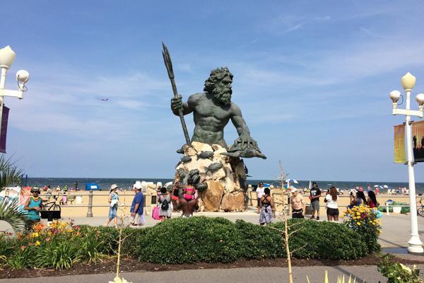 A statue of Poseidon adorns the busy walkway in Virginia Beach, Virginia