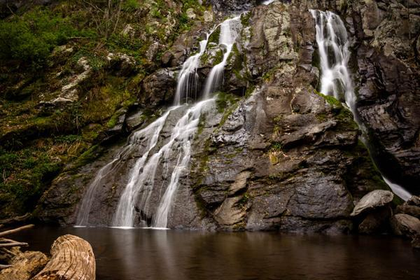 Water flows down the rock into a tranquil pool in Shenandoah National Park near Dulles, Virginia