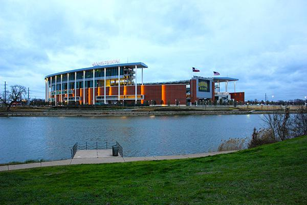 McLane Football Stadium view from across the water at dusk in Waco, Texas