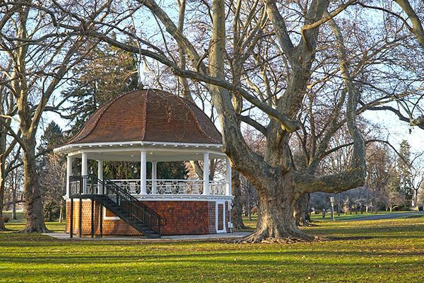 Bare trees reach up over a beautiful gazebo in Pioneer Park, Walla Walla, Washington