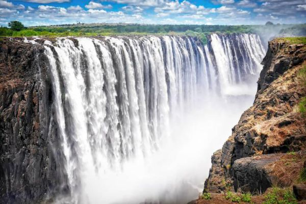 Victoria Falls is a town in western Zimbabwe and a gateway to the massive waterfall of the same name.