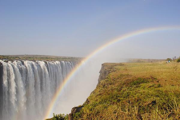 A rainbow dips into the mighty Victoria Falls in Zimbabwe